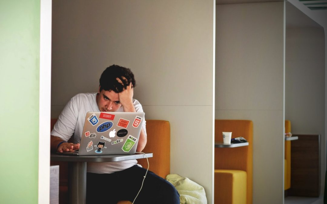 stressed student on laptop