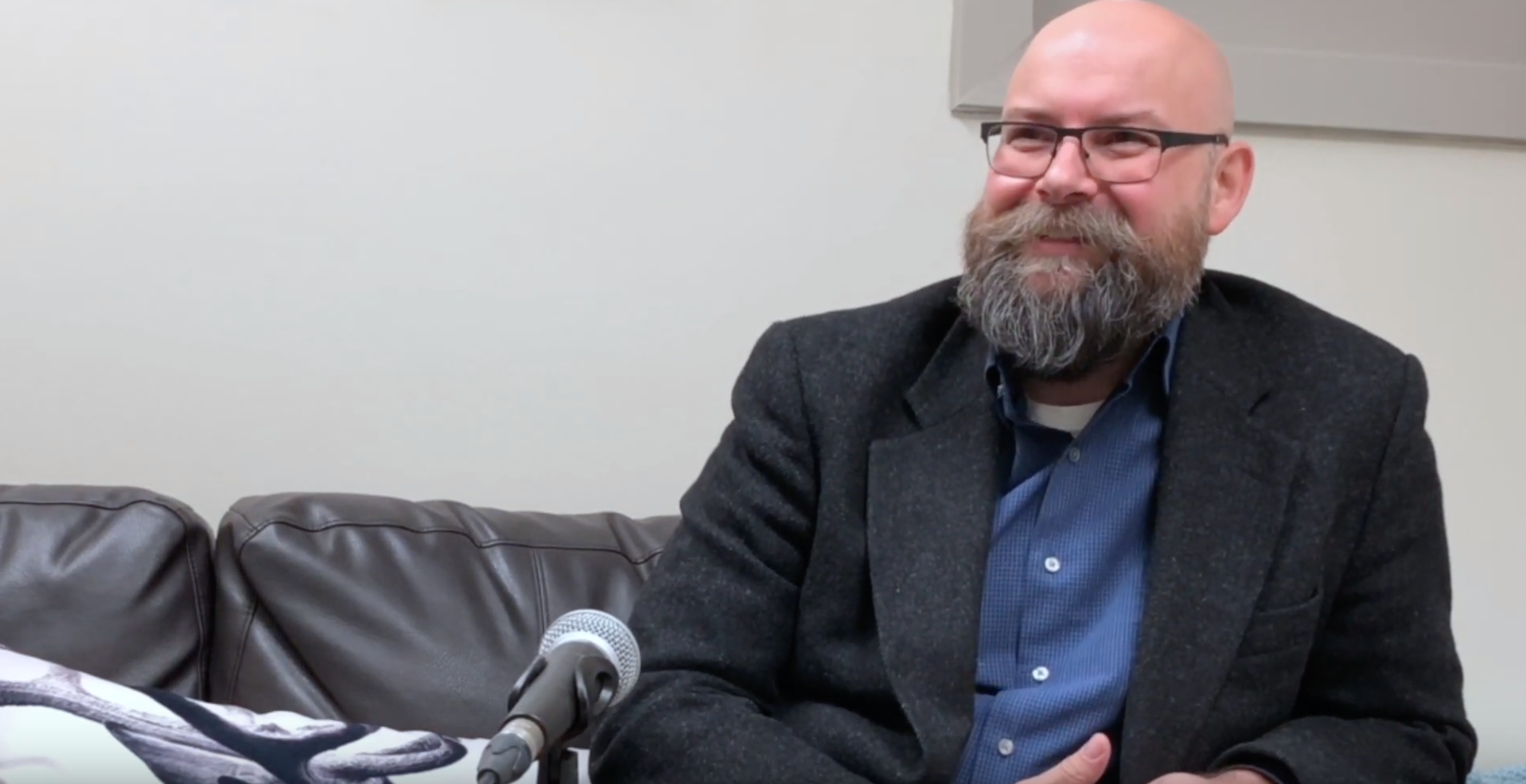 Male therapist smiling and answering a question