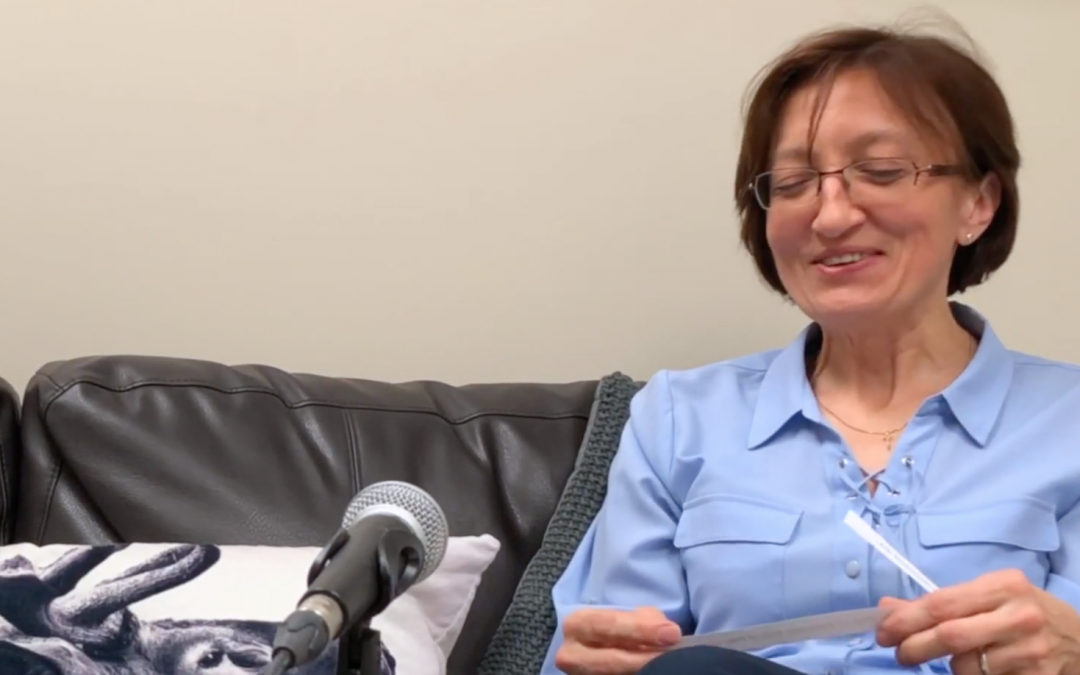 Female therapist read a question from a piece of paper